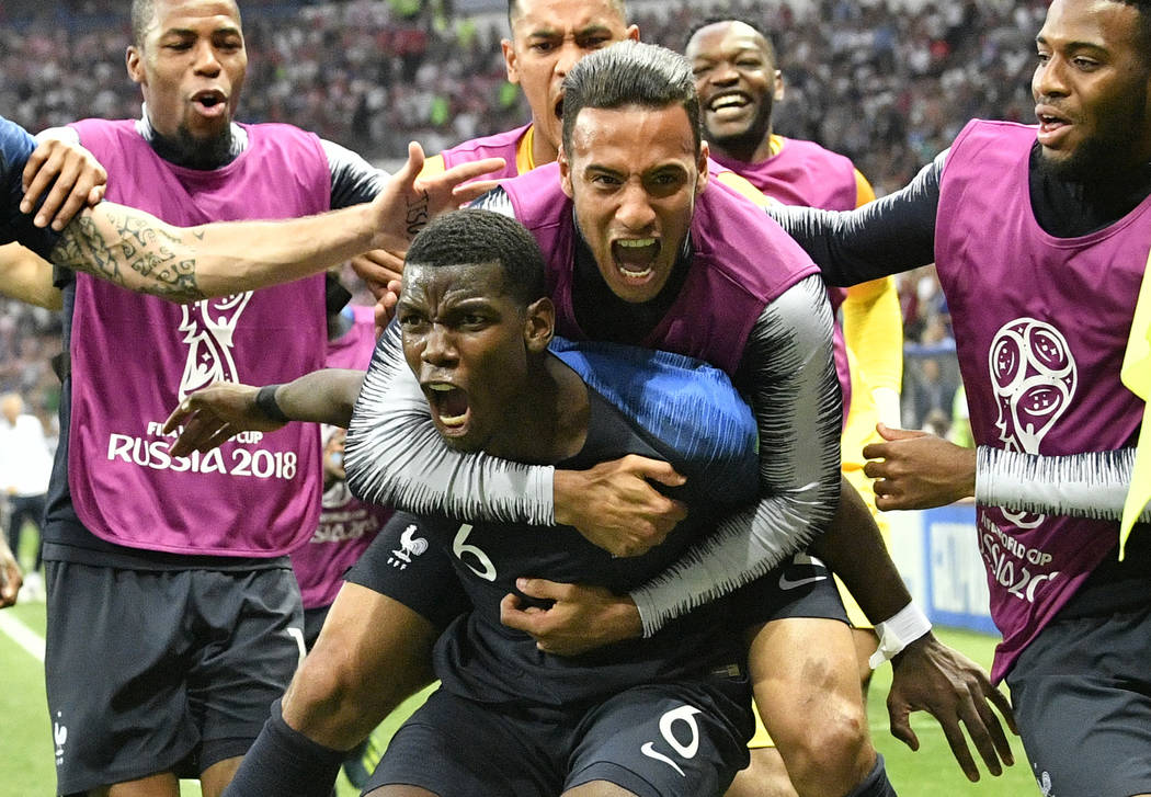 France's Paul Pogba celebrates after scoring his side's third goal during the final match between France and Croatia at the 2018 soccer World Cup in the Luzhniki Stadium in Moscow, Russia, Sunday, ...
