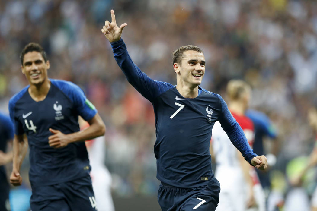 France's Antoine Griezmann celebrates after scoring on a penalty his side' second goal during the final match between France and Croatia at the 2018 soccer World Cup in the Luzhniki Stadium in Mos ...