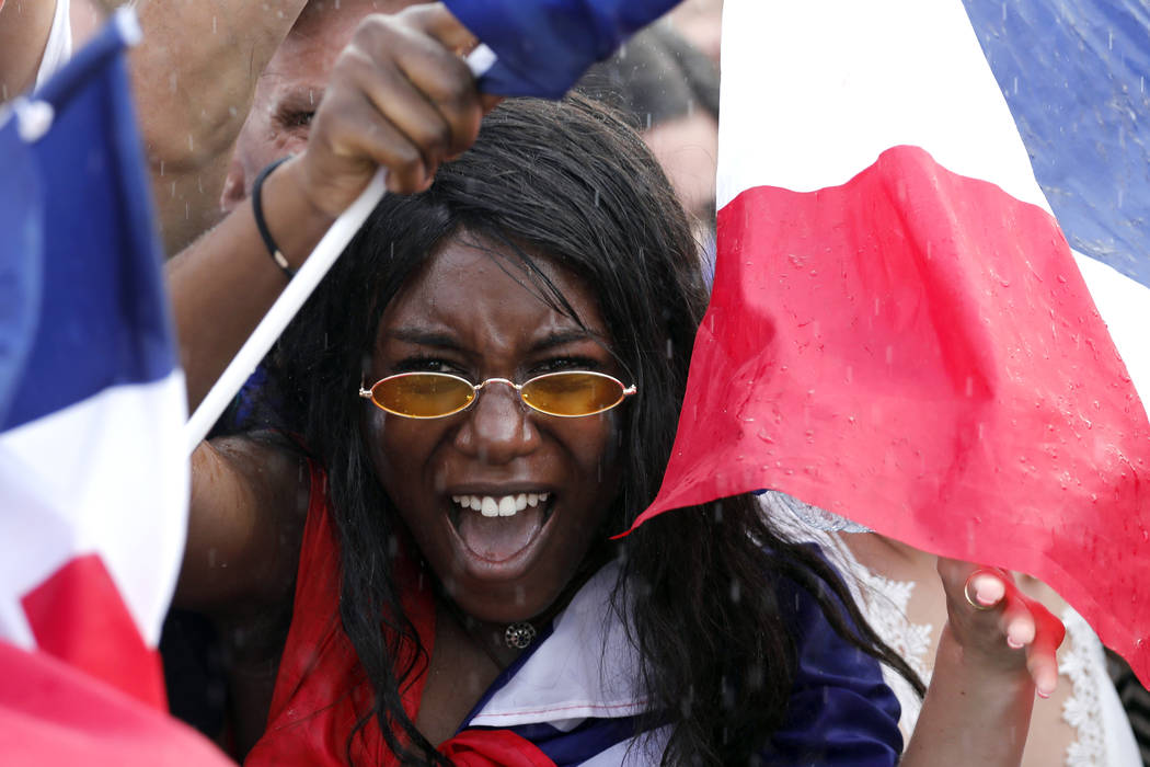 A French soccer team supporter shouts on the Champ de Mars as she watches the World Cup final between France and Croatia, Sunday, July 15, 2018 in Paris. (AP Photo/Laurent Cipriani)