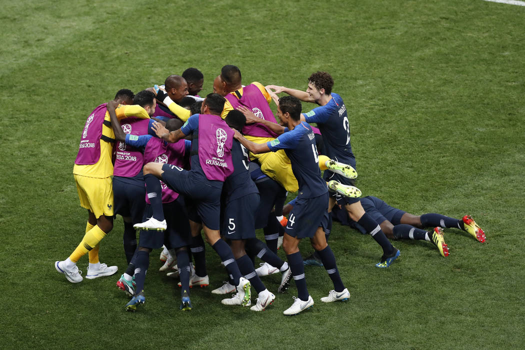 France players celebrate after Kylian Mbappe scored their side's fourth goal during the final match between France and Croatia at the 2018 soccer World Cup in the Luzhniki Stadium in Moscow, Russi ...