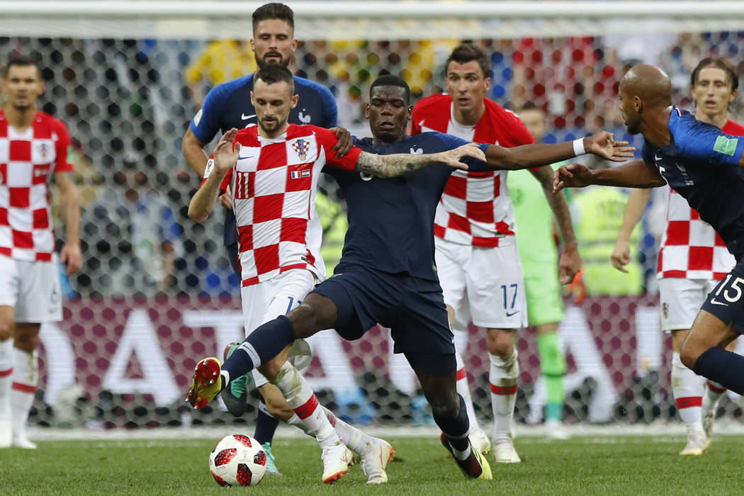 Croatia's Marcelo Brozovic, left, vies for the ball with France's Paul Pogba during the final match between France and Croatia at the 2018 soccer World Cup in the Luzhniki Stadium in Moscow, Russi ...