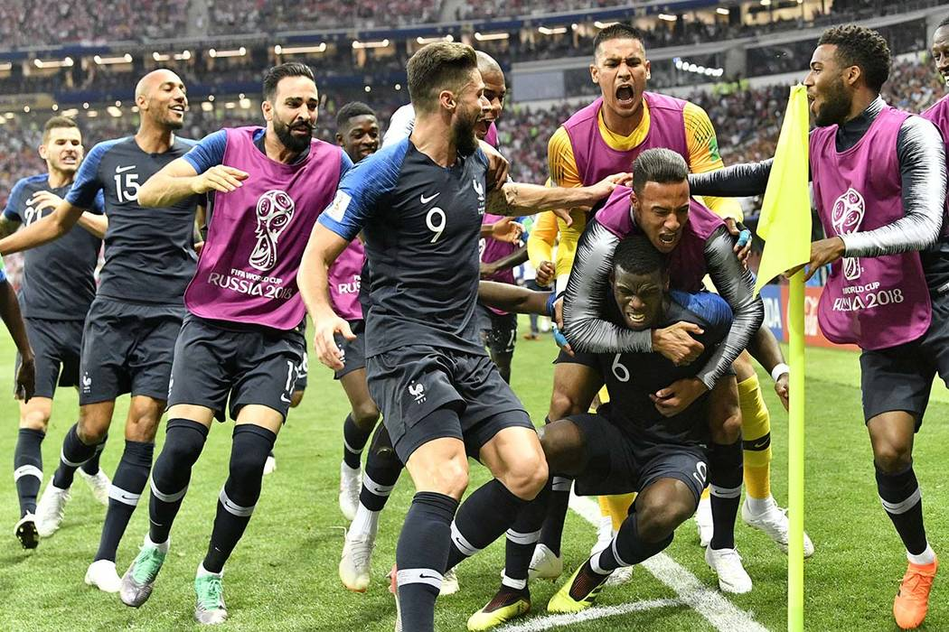 France's Paul Pogba, third from right, celebrates with his teammates after scoring his side's third goal during the final match between France and Croatia at the 2018 soccer World Cup in the Luzhn ...