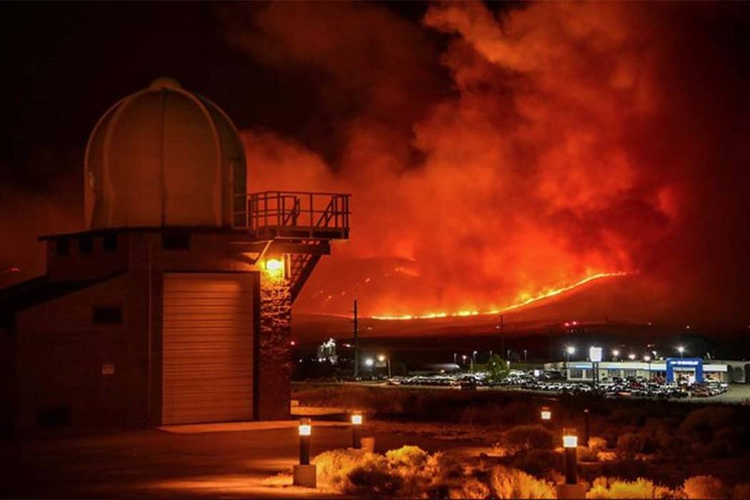 The Silver State fire burns in the hlls outside of Elko on Saturday night. (Derek Williams/National Weather Service)