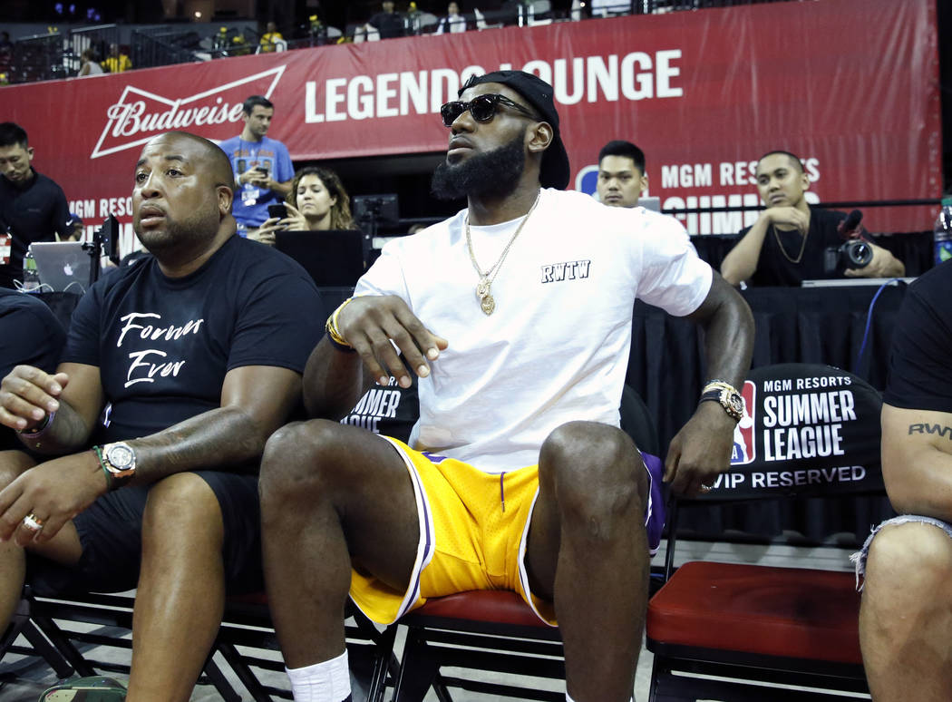 The Los Angeles Lakers  LeBron James watches an NBA Summer League  basketball game between the d22ff4590