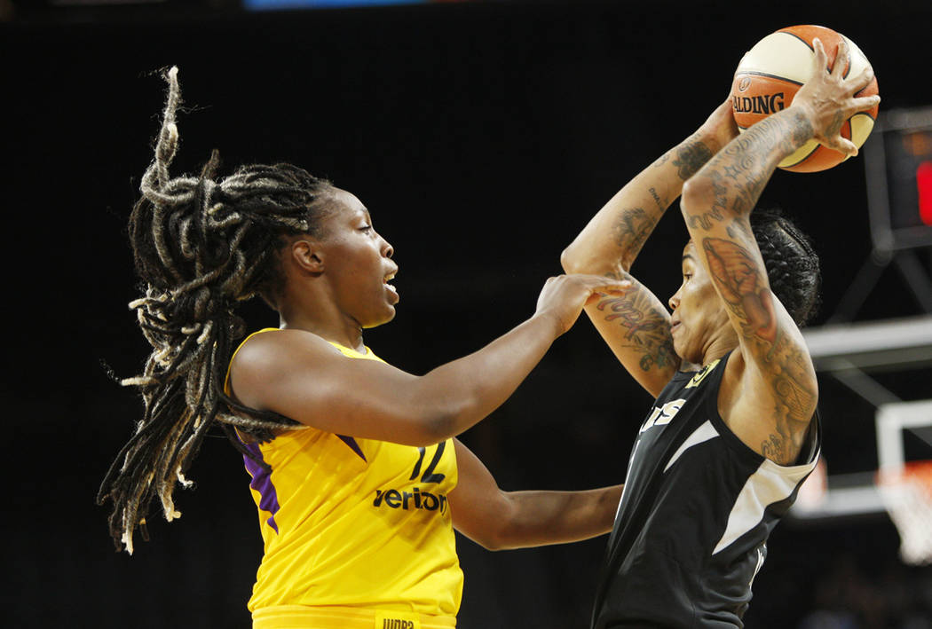 Las Vegas Aces forward Tamara Young (1) shoots a basket against Los Angeles Sparks guard Chelsea Gray (12) during the first half of a WNBA basketball game at the Mandalay Bay Events Center in Las ...