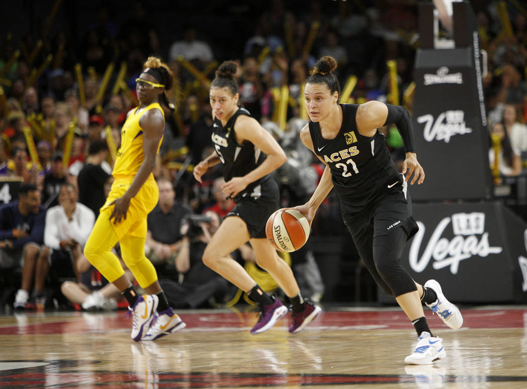 Las Vegas Aces guard Kayla McBride (21) dribbles down the court during the second half of a WNBA basketball game against the Los Angeles Sparks at the Mandalay Bay Events Center in Las Vegas, Sund ...