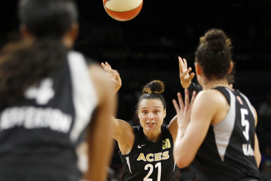 Las Vegas Aces guard Kayla McBride (21) passes to teammate forward Dearica Hamby (5) during the second half of a WNBA basketball game against the Los Angeles Sparks at the Mandalay Bay Events Cent ...