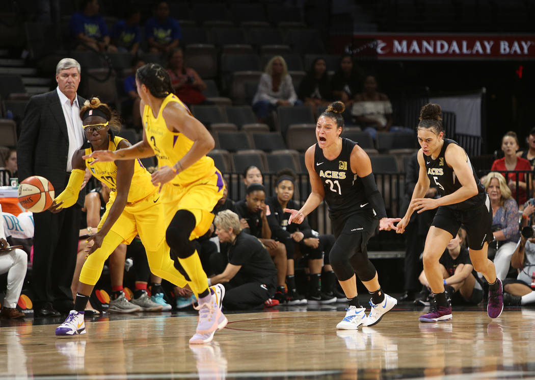 Las Vegas Aces guard Kayla McBride (21) reacts after Los Angeles Sparks forward/guard Essence Carson (17) steals the ball during the first half of a WNBA basketball game at the Mandalay Bay Events ...