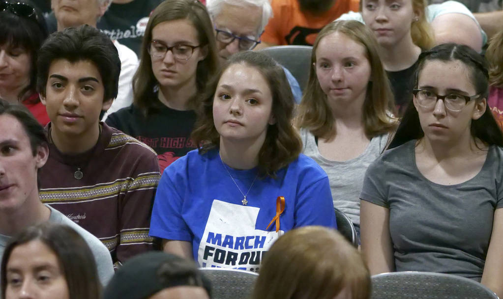 Young audience members listen as students from Marjory Stoneman Douglas High School, the Parkland, Florida, school where 17 people were shot dead in February, speak during a town hall at the Mount ...