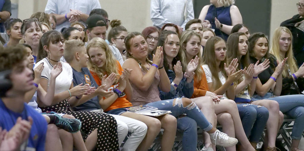 Young audience members applaud while listening to students from Marjory Stoneman Douglas High School, the Parkland, Florida, school where 17 people were shot dead in February, speak during a town ...