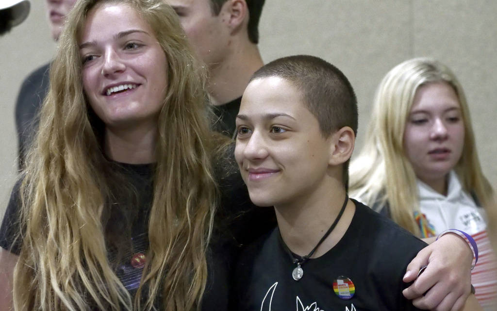 Emma Gonzalez, right, a student from Marjory Stoneman Douglas High School, poses for a photograph during a town hall at the Mountain America Expo Center Saturday, July 14, 2018, in Sandy, Utah. (A ...