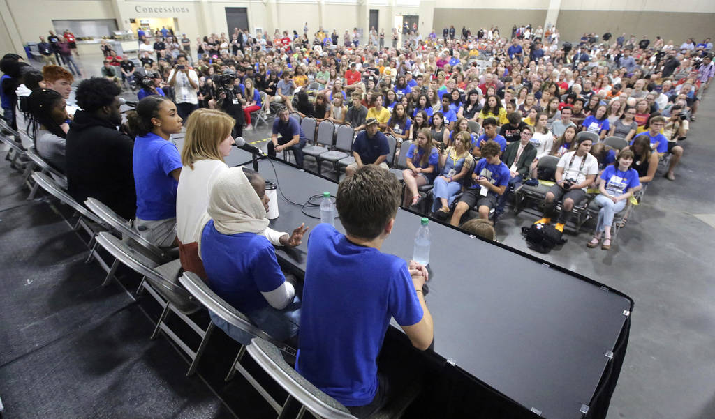 Students from Marjory Stoneman Douglas High School, the Parkland, Florida, school where 17 people were shot dead in February, and other March for Our Lives panel members speak during a town hall a ...