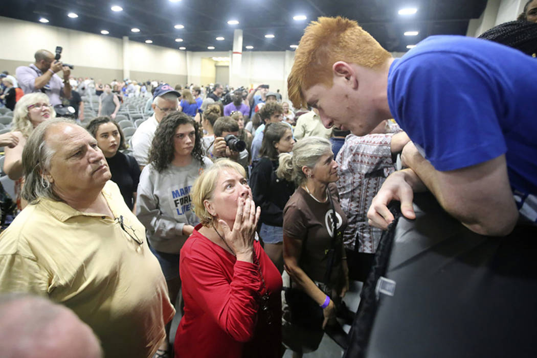 Ryan Deitsch, right, a student from Marjory Stoneman Douglas High School, speaks with Eve O'Neill following a town hall at the Mountain America Expo Center Saturday, July 14, 2018, in Sandy, Utah. ...