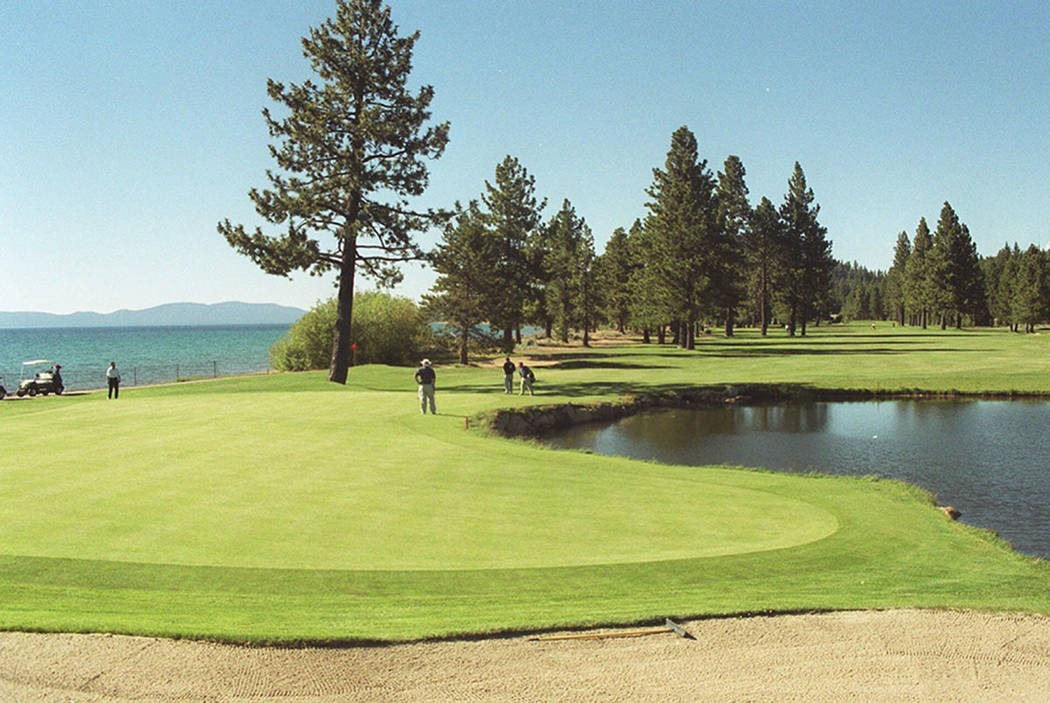 The 18th green is seen at Edgewood Tahoe Golf Course, the site of the American Century Championship at Stateline, Nev. (AP Photo/Reno Gazette-Journal, Tim Dunn)