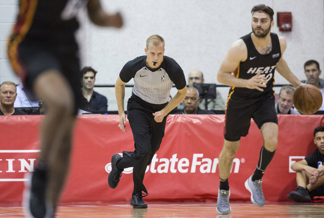 Referee Tyler Ricks (36) works the Miami Heat's NBA Summer League game with the New Orleans Pelicans on Thursday, July 12, 2018, at Cox Pavilion, in Las Vegas. Benjamin Hager Las Vegas Review-Jour ...