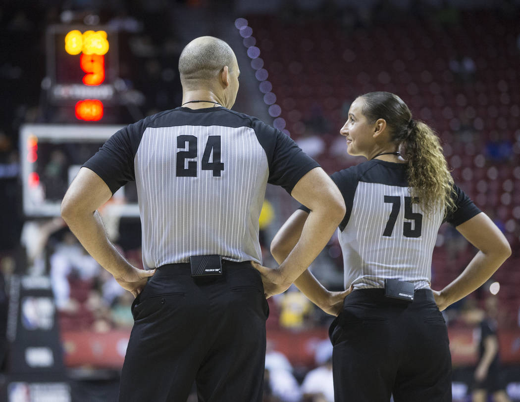 Referees Brandon Adair (24) and Ashley Moyer-Gleich (75) talk during a timeout during the Phoenix Suns NBA Summer League game with the Philadelphia 76ers on Thursday, July 12, 2018, at the Thomas ...