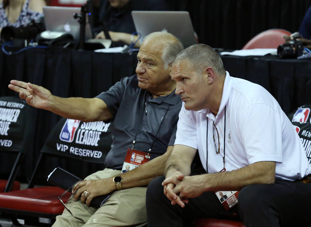 The N.B.A. referee Bennett Salvatore, left, and Monty McCutchen, NBA's head of referee development, discuss during an NBA Summer League basketball game at the Thomas and Mack Center on Sunday, Jul ...