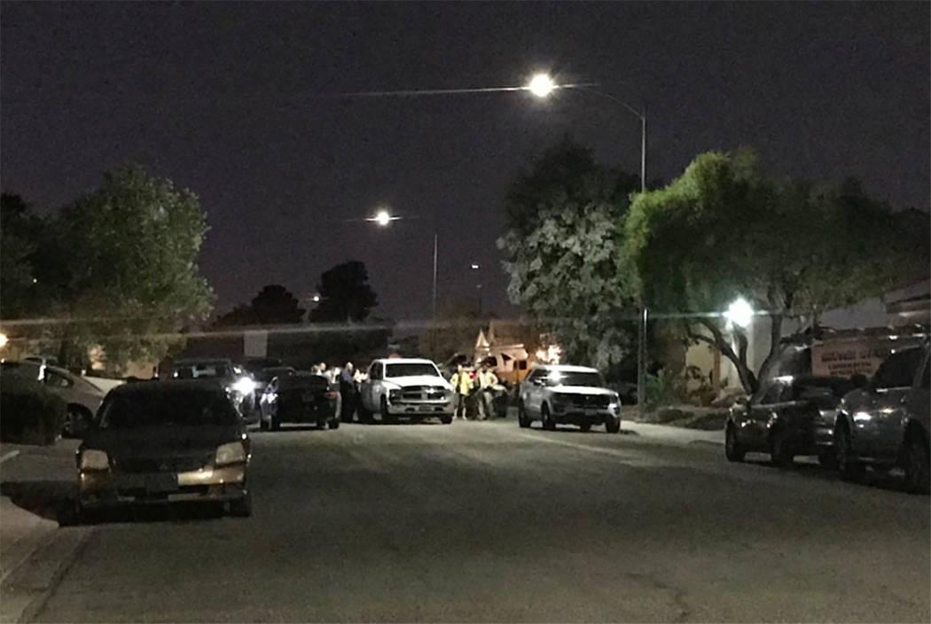 Las Vegas police work the scene of a homicide in the 1600 block of Palmae Way in Las Vegas on Sunday night. (Blake Apgar/Las Vegas Review-Journal)