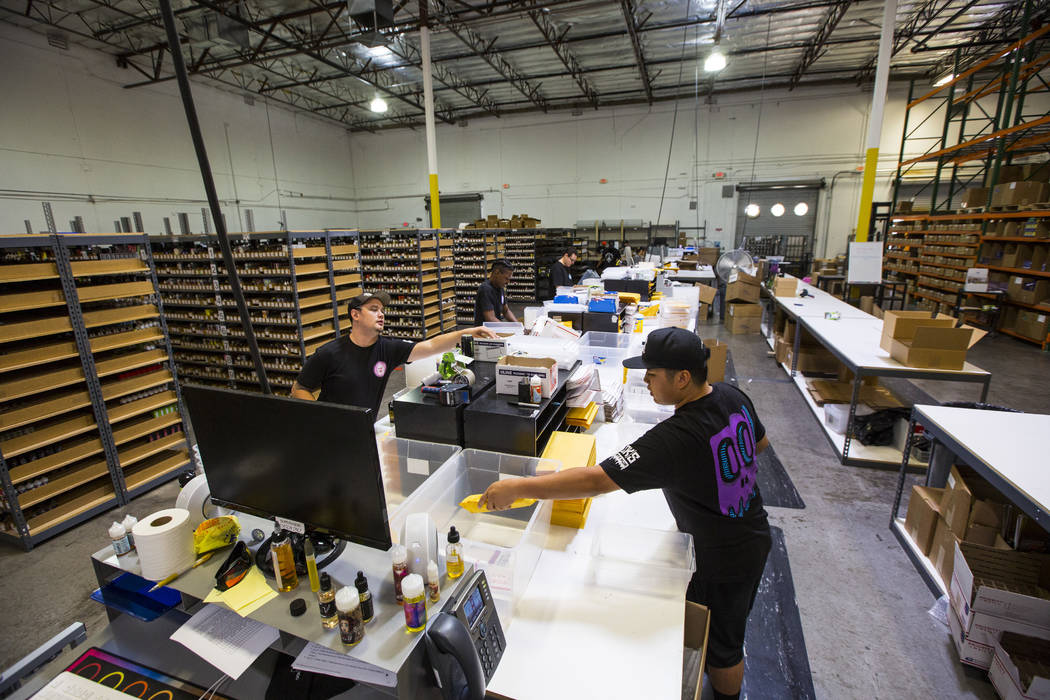 Justin Abellera, right, packs up items to be shipped at the eCig Distributors warehouse near McCarran International Airport in Las Vegas on Friday, July 13, 2018. Chase Stevens Las Vegas Review-Jo ...
