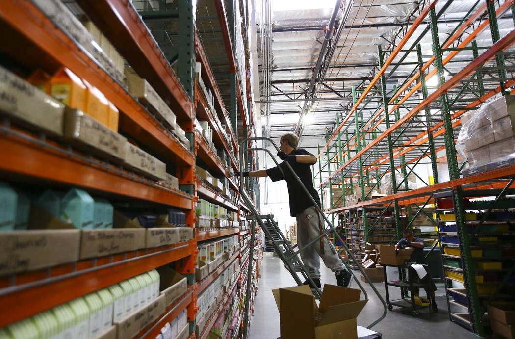 William Forgie retrieves an item at the eCig Distributors warehouse near McCarran International Airport in Las Vegas on Friday, July 13, 2018. Chase Stevens Las Vegas Review-Journal @csstevensphoto
