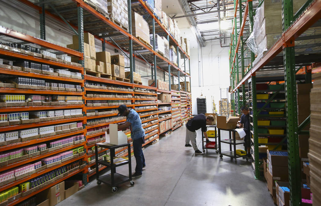 Employees retrieve items for online and wholesale orders at the eCig Distributors warehouse near McCarran International Airport in Las Vegas on Friday, July 13, 2018. Chase Stevens Las Vegas Revie ...