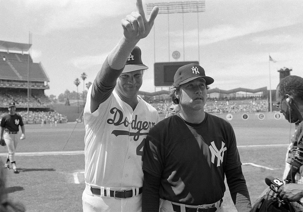 Los Angeles Dodger pitcher Jerry Reuss gives the big number one standing with New York Yankees Rich Gossage during warm-ups on Monday, July 8, 1980 in Los Angeles for the All-Star game Tuesday.(AP ...