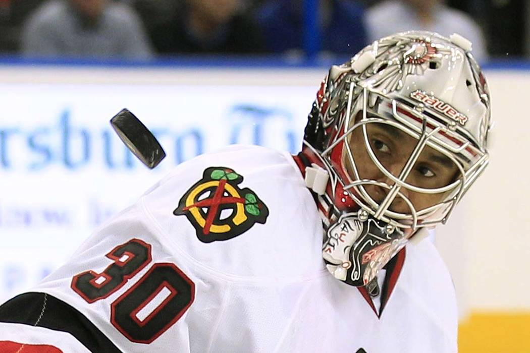 Chicago Blackhawks goalie Ray Emery keeps his eyes on a shot by the Tampa Bay Lightning during the second period of an NHL hockey game in Tampa, Fla., on Nov. 4, 2011. Emery drowned Sunday in his ...