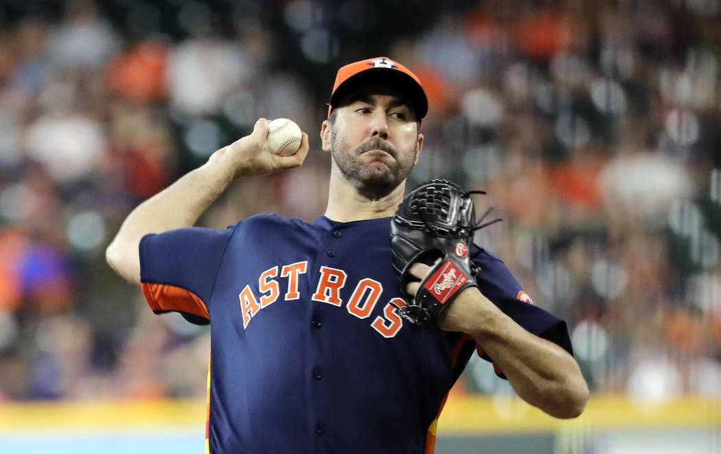 Houston Astros starting pitcher Justin Verlander throws against the Detroit Tigers during the first inning of a baseball game Sunday, July 15, 2018, in Houston. (AP Photo/David J. Phillip)