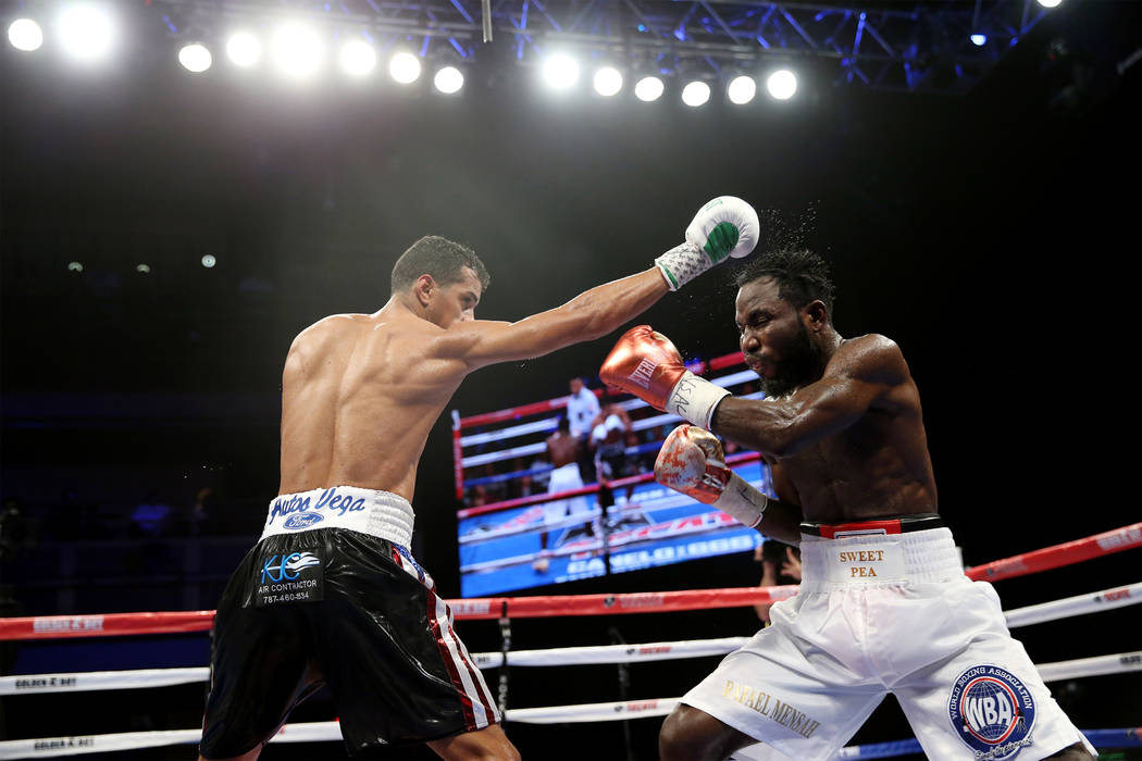 Alberto Machado, left, battles Rafael Mensah in the WBA Super Featherweight Title bout at Hard Rock Hotel in Las Vegas, Saturday, July 21, 2018. Machado won by unanimous decision. Erik Verduzco La ...