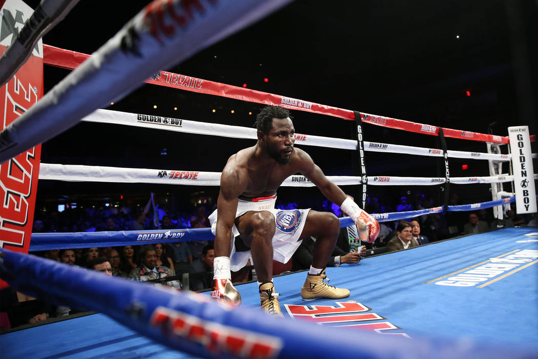 Rafael Mensah is knocked down by Alberto Machado, not pictured, in the WBA Super Featherweight Title bout at Hard Rock Hotel in Las Vegas, Saturday, July 21, 2018. Machado won by unanimous decisio ...