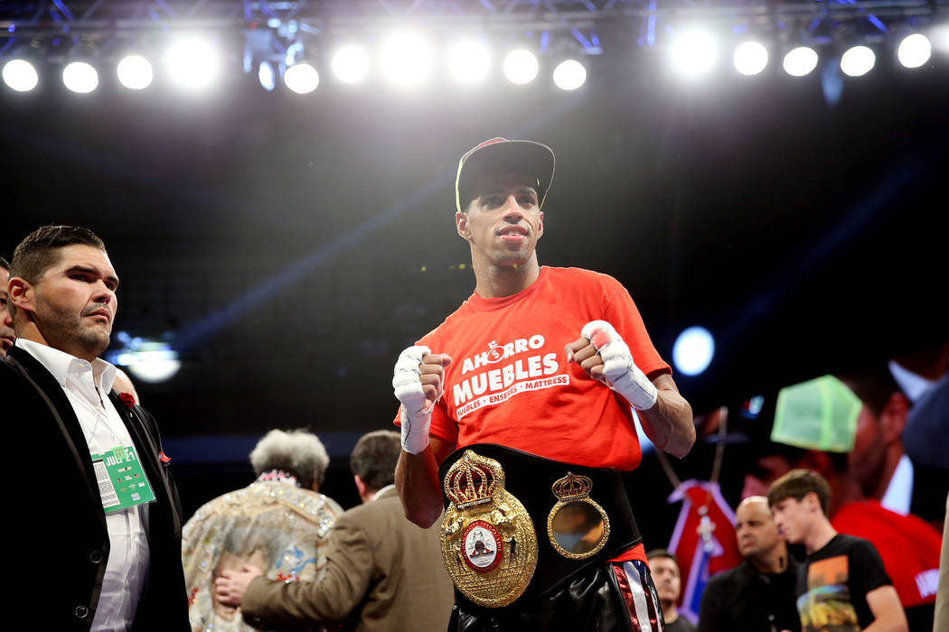 Alberto Machado celebrates after his unanimous decision win against Rafael Mensah in the WBA Super Featherweight Title bout at Hard Rock Hotel in Las Vegas, Saturday, July 21, 2018. Erik Verduzco ...