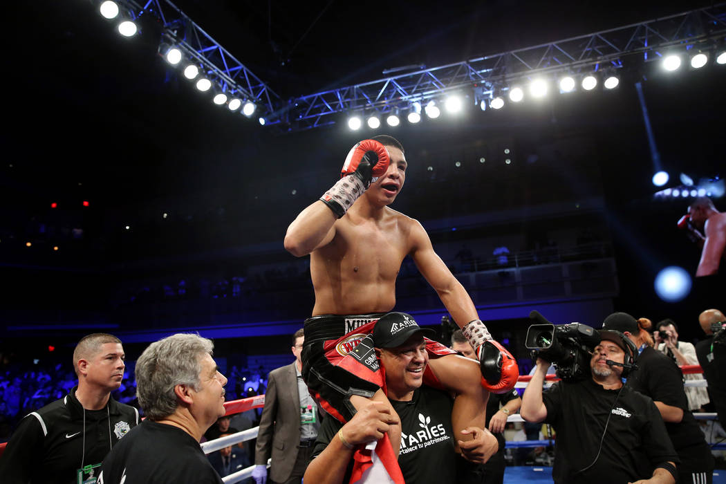 Jaime Munguia reacts after his fight against Liam Smith in the WBO Super Welterweight Title bout at Hard Rock Hotel in Las Vegas, Saturday, July 21, 2018. Munguia won by unanimous decision. Erik V ...