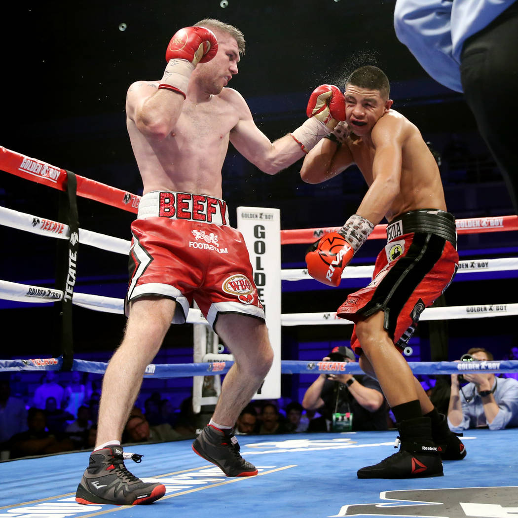 Liam Smith, left, connects a punch against Jaime Munguia in the WBO Super Welterweight Title bout at Hard Rock Hotel in Las Vegas, Saturday, July 21, 2018. Munguia won by unanimous decision. Erik ...