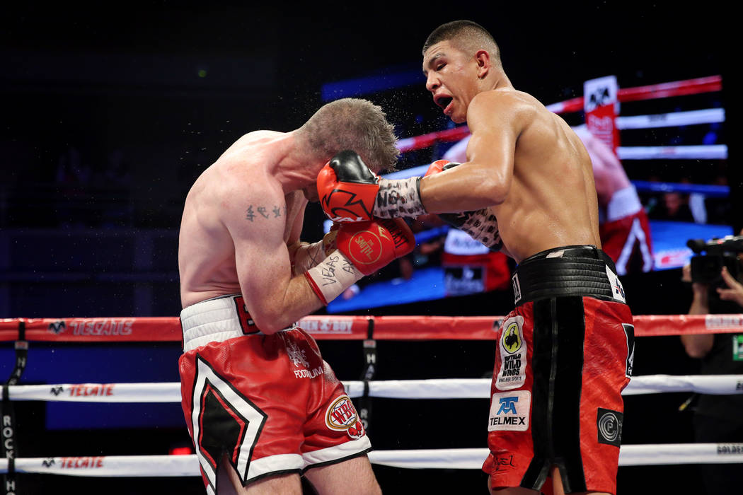 Jaime Munguia, right, connects a punch against Liam Smith in the WBO Super Welterweight Title bout at Hard Rock Hotel in Las Vegas, Saturday, July 21, 2018. Munguia won by unanimous decision. Erik ...