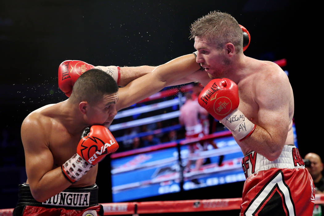 Jaime Munguia, left, battles Liam Smith in the WBO Super Welterweight Title bout at Hard Rock Hotel in Las Vegas, Saturday, July 21, 2018. Munguia won by unanimous decision. Erik Verduzco Las Vega ...