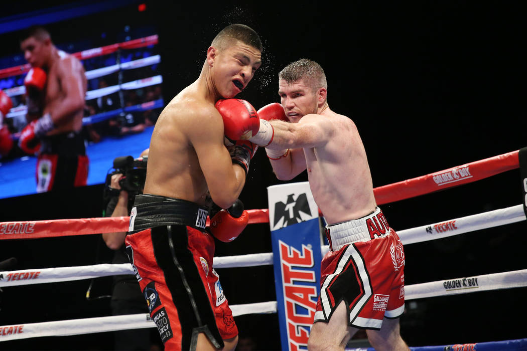 Liam Smith, right, connects a punch against Jaime Munguia in the WBO Super Welterweight Title bout at Hard Rock Hotel in Las Vegas, Saturday, July 21, 2018. Munguia won by unanimous decision. Erik ...