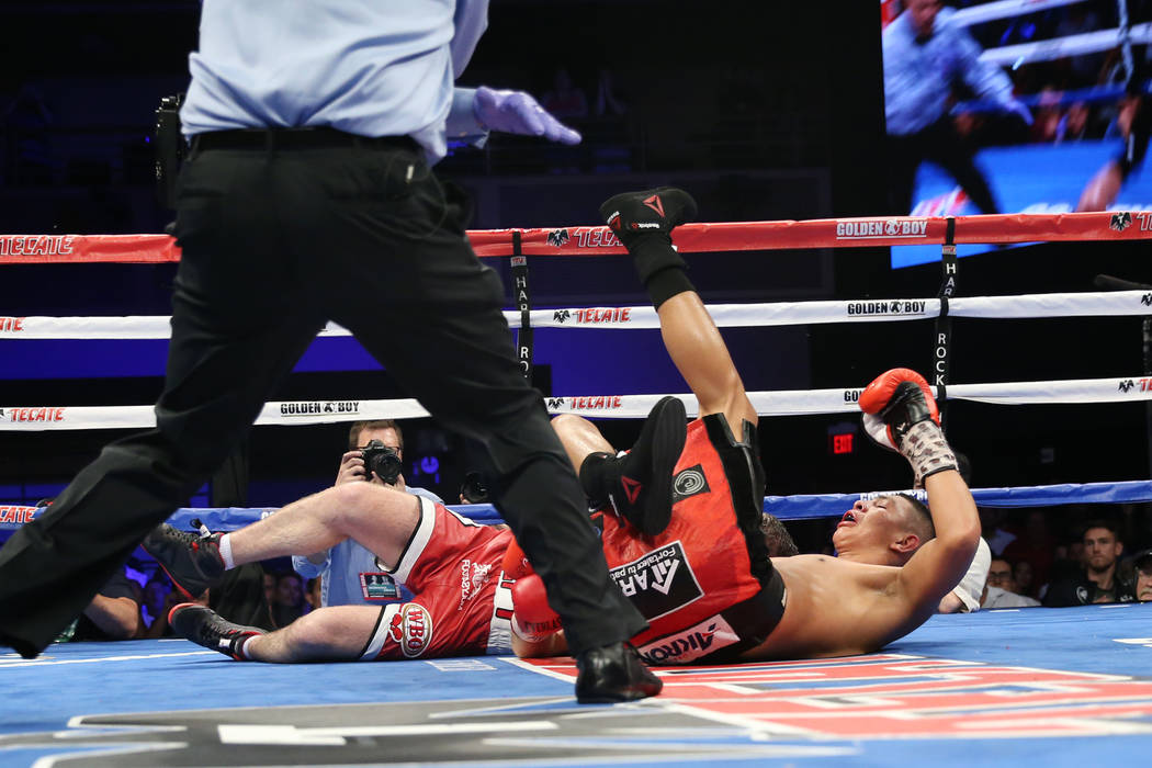 Liam Smith, left, and Jaime Munguia take a fall during the WBO Super Welterweight Title bout at Hard Rock Hotel in Las Vegas, Saturday, July 21, 2018. Munguia won by unanimous decision. Erik Verdu ...