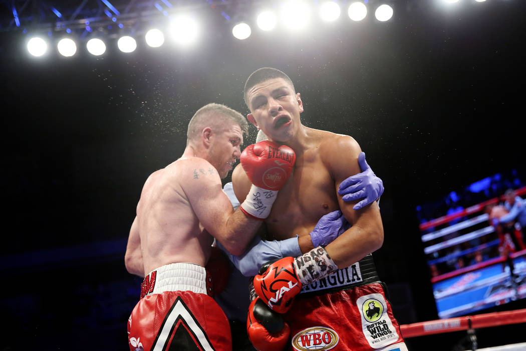 Liam Smith, left, lands a punch after the bell against Jaime Munguia in the WBO Super Welterweight Title bout at Hard Rock Hotel in Las Vegas, Saturday, July 21, 2018. Munguia won by unanimous dec ...