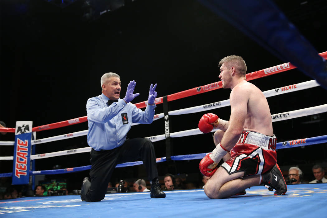 Liam Smith get a count after getting knocked down against Jaime Munguia, not pictured, in the WBO Super Welterweight Title bout at Hard Rock Hotel in Las Vegas, Saturday, July 21, 2018. Munguia wo ...