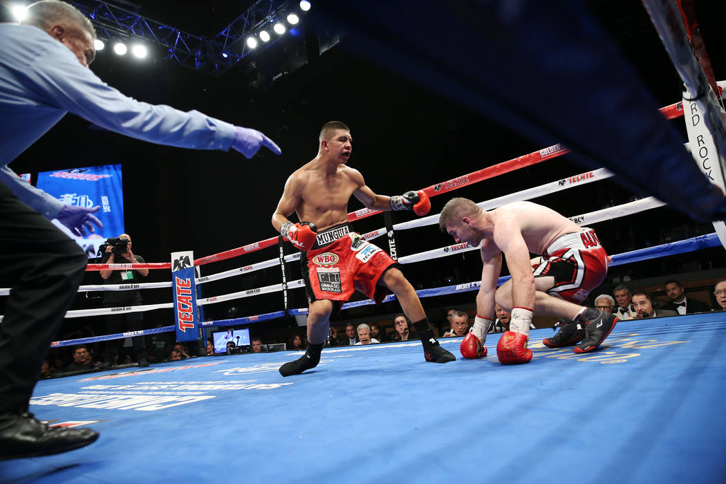 Jaime Munguia, left, knocks down Liam Smith in the WBO Super Welterweight Title bout at Hard Rock Hotel in Las Vegas, Saturday, July 21, 2018. Munguia won by unanimous decision. Erik Verduzco Las ...