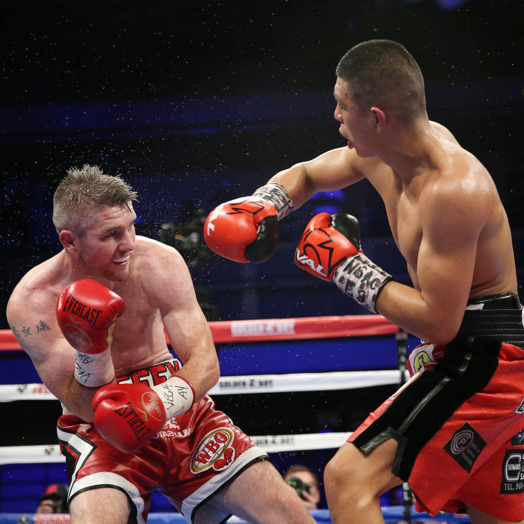 Liam Smith, left, and Jaime Munguia battle in the WBO Super Welterweight Title bout at Hard Rock Hotel in Las Vegas, Saturday, July 21, 2018. Munguia won by unanimous decision. Erik Verduzco Las V ...