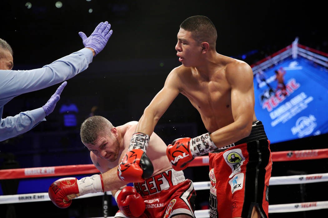 Liam Smith, left, battles Jaime Munguia in the WBO Super Welterweight Title bout at Hard Rock Hotel in Las Vegas, Saturday, July 21, 2018. Munguia won by unanimous decision. Erik Verduzco Las Vega ...