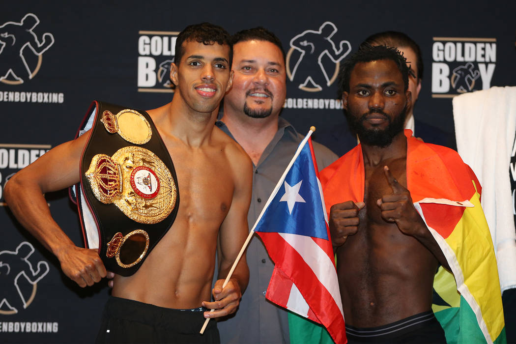 Alberto Machado, left, and Rafael Mensah during their official weigh-in event at the Hard Rock Hotel in Las Vegas, Friday, July 20, 2018. Machado and Mensah are fighting for the WBA Super Featherw ...
