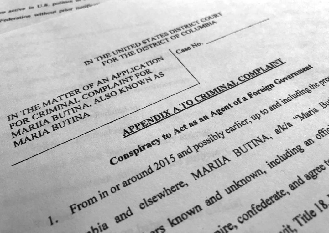 Court papers unsealed Monday, July 16, 2018, photographed in Washington, shows part of the criminal complaint against Maria Butina. She was arrested July 15, on a charge of conspiracy to act as an ...