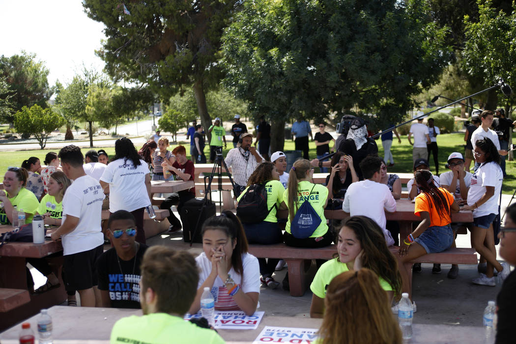 People gather at a Road to Change Voter Registration Walk at Sunset Park in Las Vegas, Monday, July 16, 2018. The event was put on by the March For Our Lives group, created after the Parkland shoo ...