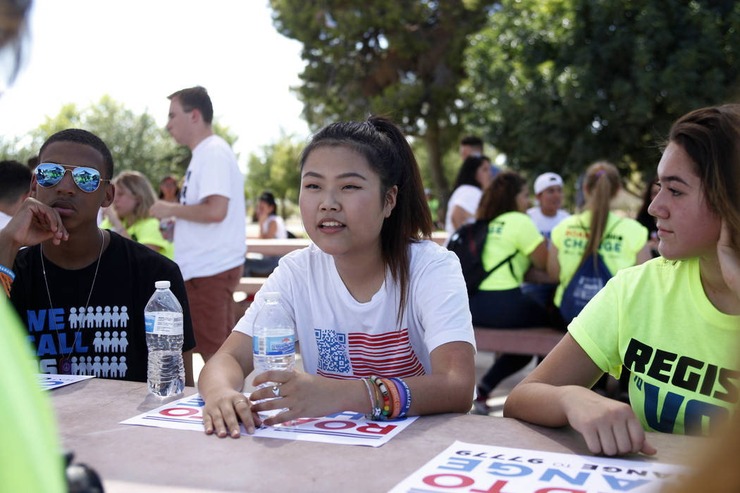 Kelly Choi, 17, speaks to her group at a Road to Change Voter Registration Walk at Sunset Park in Las Vegas, Monday, July 16, 2018. The event was put on by the March For Our Lives group, created a ...