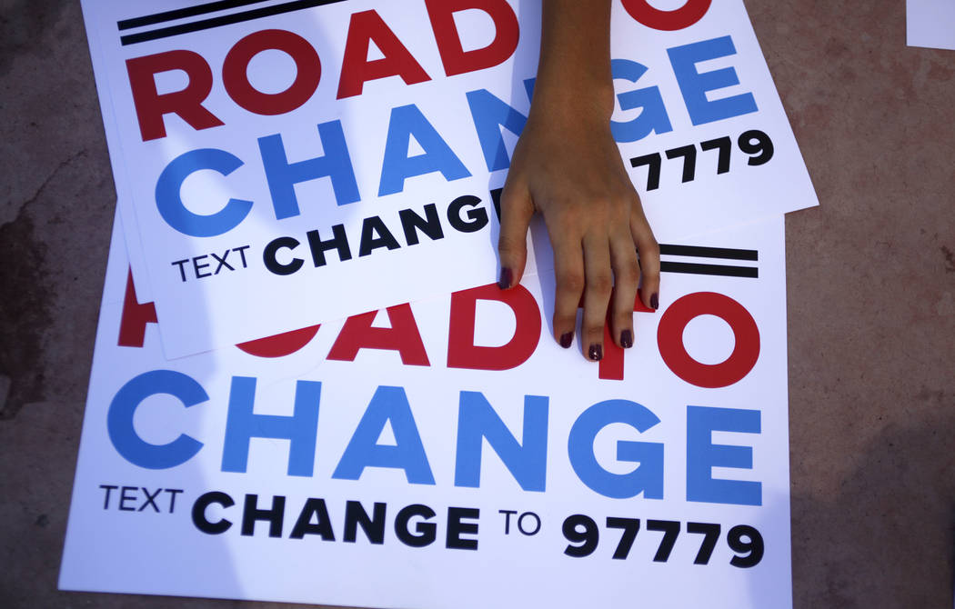 Signs at a Road to Change Voter Registration Walk at Sunset Park in Las Vegas, Monday, July 16, 2018. The event was put on by the March For Our Lives group, created after the Parkland shooting to ...