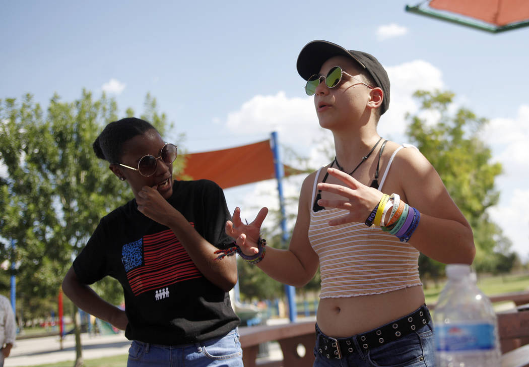 Ariel Hobbs, left, listens as Emma Gonzales speaks at a Road to Change Voter Registration Walk at Sunset Park in Las Vegas, Monday, July 16, 2018. The event was put on by the March For Our Lives g ...