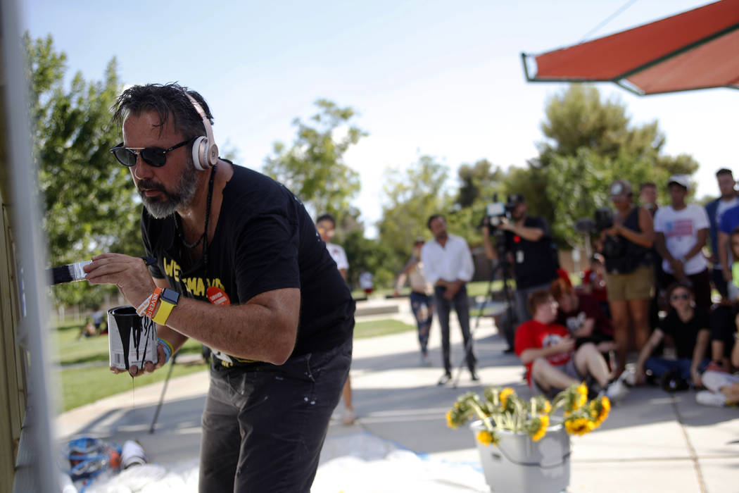 Manny Oliver paints a mural at a Road to Change Voter Registration Walk at Sunset Park in Las Vegas, Monday, July 16, 2018. The event was put on by the March For Our Lives group, created after the ...