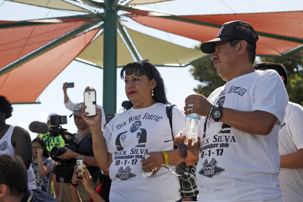 Angelica Cervantes, left, and her husband Gregorio De La Rosa watch Manny Oliver create a mural at a Road to Change Voter Registration Walk at Sunset Park in Las Vegas, Monday, July 16, 2018. The ...
